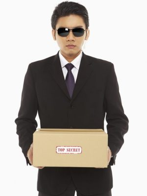 """Security staff holding a """"Top Secret"""" package"""